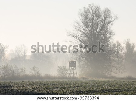 Wildlife observatory in the autumn  foggy morning - stock photo