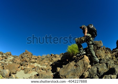 wildlife photographer outdoor in summer in Tiede crater, Tenerife, Spain - stock photo