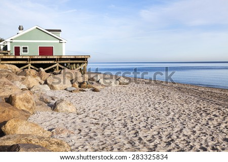 Wildwood beach. Concession stand, boulders, beach and ocean. Long Island, New York. - stock photo
