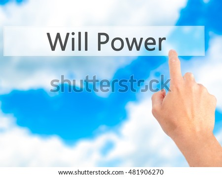 Will Power - Hand pressing a button on blurred background concept . Business, technology, internet concept. Stock Photo