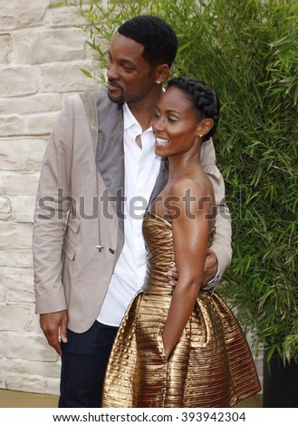 """Will Smith and Jada Pinkett Smith at the Los Angeles Premiere of """"The Karate Kid"""" held at the Mann Village Theater in Westwood, California, United States on June 7, 2010.   - stock photo"""