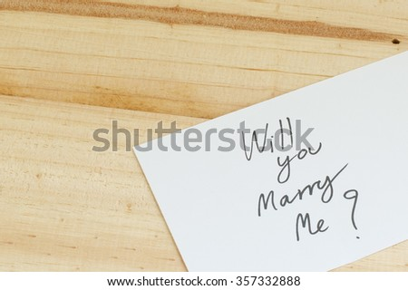 Will you marry me words written on paper - stock photo