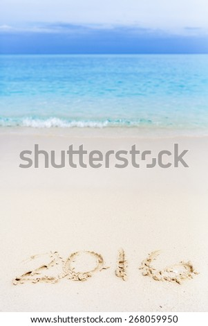 Will you Travel in 2016 ? New Year Numbers Written down on the Beach - stock photo