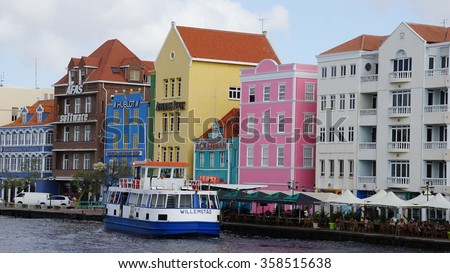 WILLEMSTAD, ARUBA - NOV 25: View of Williamsted in Aruba, as seen on Nov 25, 2015. The city centre, with its unique architecture and harbour entry, has been designated a UNESCO World Heritage Site. - stock photo