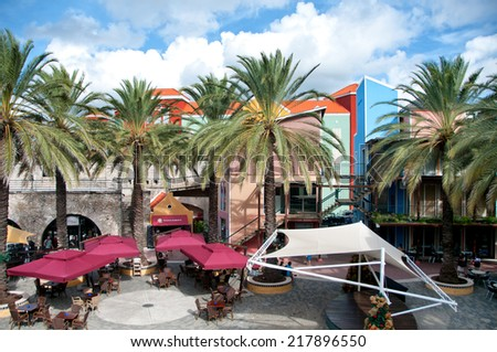 WILLEMSTAD (CURACAO) - CIRCA DECEMBER 2013 - Rif Fort outdoor restaurant and street market in Willemstad, Curacao, Dutch Antilles in an urban square lined with tropical palm trees on a sunny day