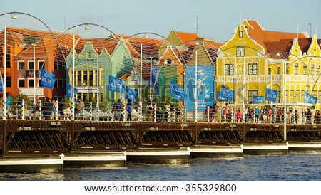 WILLEMSTAD, CURACAO - NOV 25: Queen Emma Pontoon Bridge across St. Anna Bay in Willemstad, Curacao, on Nov 25, 2015. The bridge is hinged and opens regularly to enable passage of oceangoing vessels. - stock photo