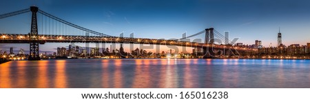 Williamsburg bridge at dusk spanning the East River between Brooklyn and downtown Manhattan (86Mpx photo) - stock photo