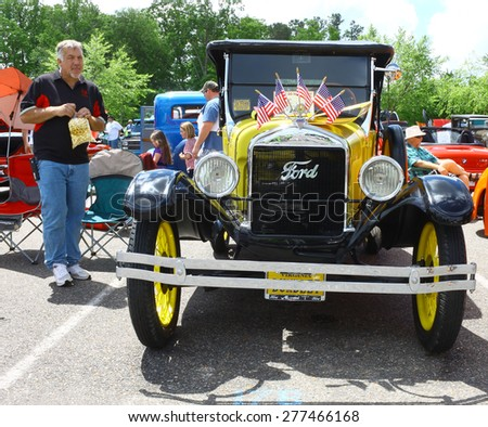 WILLIAMSBURG, VA - May 9, 2015: A Canary yellow 1926 Ford Model T at the 6th Annual Project Lifesaver Car Show in Williamsburg Virginia on a summer day. - stock photo