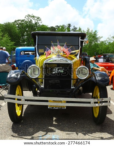 WILLIAMSBURG, VA - May 9, 2015: A Canary yellow 1926 Ford Model T at the6th Annual Project Lifesaver Car Show in Williamsburg Virginia on a summer day. - stock photo