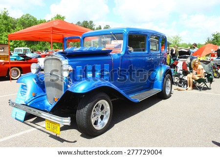 WILLIAMSBURG, VA - May 9, 2015: A 1932 Chevrolet Confederate 4dr sedan at the 6th Annual Project Lifesaver Car Show in Williamsburg Virginia on a summer day. - stock photo