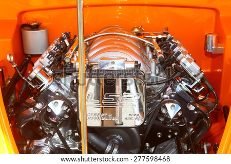 WILLIAMSBURG, VA - May 9, 2015: A Chevy LS2 smallblock in an orange 1941 Willis Coupe at the 6th Annual Project Lifesaver Car Show in Williamsburg Virginia on a summer day.  - stock photo