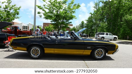 WILLIAMSBURG, VA - May 9, 2015: A two tone Olds Cutlass 442 convertible on display at the 6th Annual Project Lifesaver Car Show in Williamsburg Virginia on a summer day.  - stock photo