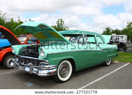 WILLIAMSBURG, VA - May 9, 2015: An old classic 1950's two tone green classic car at the 6th Annual Project Lifesaver Car Show in Williamsburg Virginia on a summer day. - stock photo