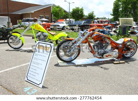 WILLIAMSBURG, VA - May 9, 2015: Two customized motorcycles at the 6th Annual Project Lifesaver Car Show in Williamsburg Virginia on a summer day. - stock photo