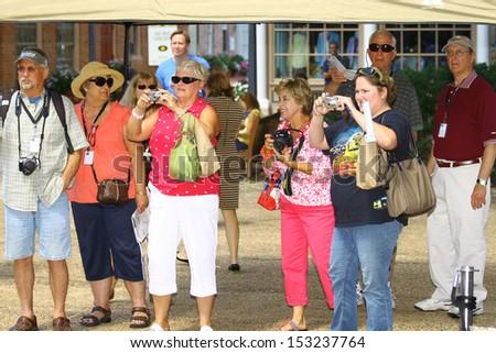 WILLIAMSBURG, VA- SEPTEMBER 5: Kyle Buschs #18 NASCAR fans waiting outside at the 1st History meets Horsepower show in Williamsburg, Virginia on September 5, 2013 - stock photo