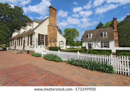 WILLIAMSBURG, VIRGINIA - APRIL 21 2012: Restored buildings on Duke of Gloucester Street in Colonial Williamsburg. The restored town is a major attraction for tourists and meetings of world leaders. - stock photo