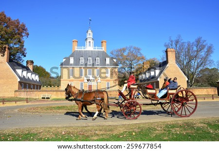 WILLIAMSBURG, VIRGINIA - NOVEMBER  19 2014: The Governors Palace in Colonial Williamsburg, Virginia. It was reconstructed on the original site after a fire destroyed it in the 1930's. - stock photo