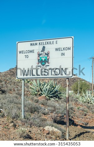 WILLISTON, SOUTH AFRICA - AUGUST 10, 2015: Welcome signboard at the entrance to Williston, a small town in the Northern Cape Karoo region of South Africa
