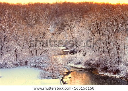 Willow Creek flows through Rock Cut State Park of Illinois on a snowy winter day - stock photo