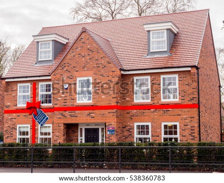 Wilmslow, Cheshire, UK. December 18th 2016. New show house decoarted with red bow in readiness for Christmas, Wilmslow, Cheshire, UK.