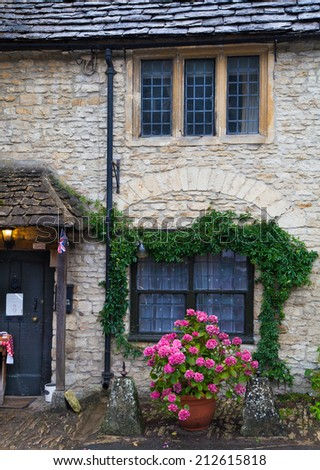 WILTSHIRE, CHIPPENHAM, UK - AUGUST 9, 2014: Castle Combe, unique old English village