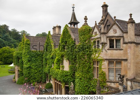 WILTSHIRE, CHIPPENHAM, UK - AUGUST 9, 2014: Castle Combe, unique old English village with luxury hotel accommodation and golf club