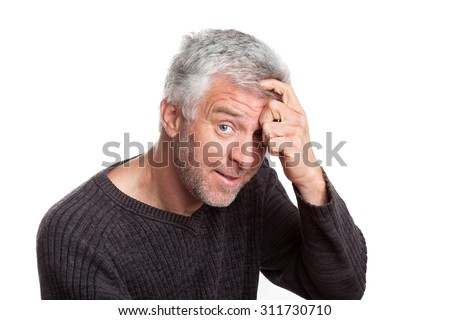 wily old gray-haired man eyeing tan isolation on a white background