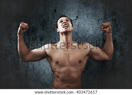 Win scream of muscular strong male athlete