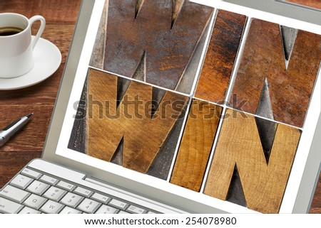 win-win - negotiation or conflict resolution strategy  -  words in letterpress wood type on a laptop screen with a cup of coffee - stock photo