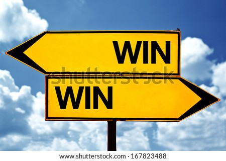 Win Win situation, opposite signs. Two opposite signs against blue sky background.