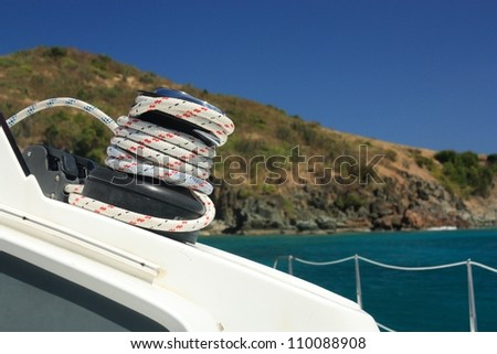 Winch and rope on sailing boat. Yachting. Detailed parts. - stock photo