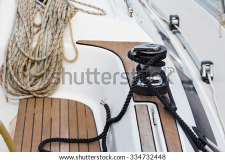 winch and ropes on a sailing boat - stock photo