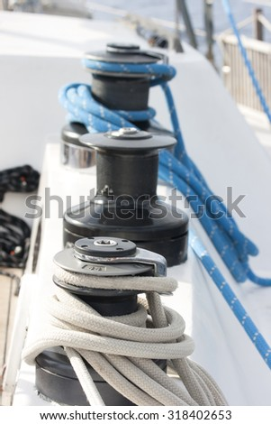 Winch with rope on the boat. capstan