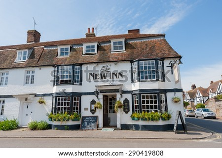 WINCHELSEA, UK - APRIL 17: The historic New Inn, a very old traditional English pub dating back to 1778 in the picturesque village of Winchelsea, UK on April 17, 2014 - stock photo