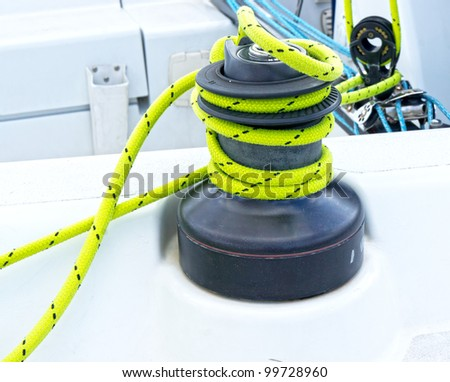 Winches to pull on sails on a boat - stock photo