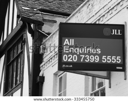 Winchester, Hampshire, England - July 31, 2015: estate agent residential house for sale sign - stock photo