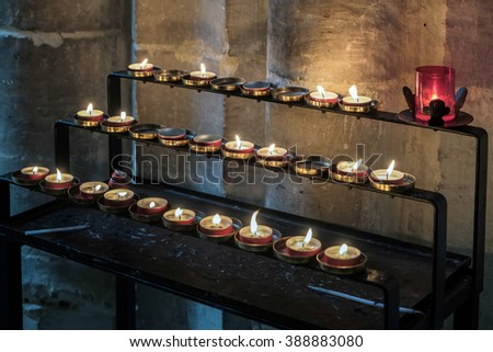WINCHESTER, HAMPSHIRE/UK - MARCH 6 : Candles in Winchester Cathedral in Winchester Hampshire on March 6, 2016
