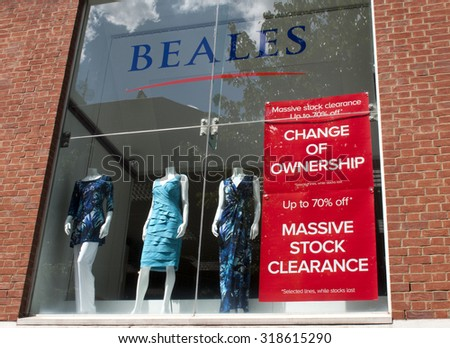 Winchester, High Street, Hampshire, England - July 31, 2015: Beales department store advertising new lines and sale, company established in 1881 founded by John Elmes - stock photo