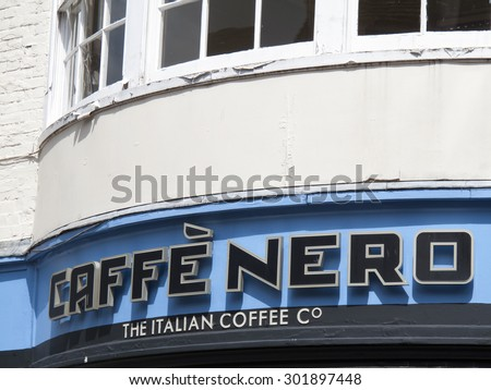 Winchester High Street Hampshire, England â?? July 31, 2015 â?? Cafe Nero Italian coffee house sign - stock photo