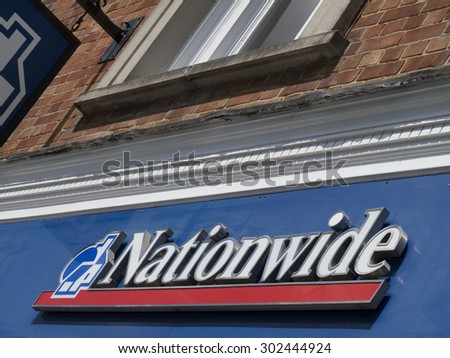 Winchester High Street, Hampshire, England - July 31, 2015: Nationwide name sign over local building society branch and is the largest building society in the world - stock photo