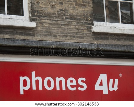 Winchester High Street, Hampshire, England - July 31, 2015: Phones 4U sign above vacant premises due to the company going into administration September 2014 - stock photo