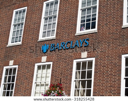 Winchester High Street, Hampshire, England - September 19, 2015: Bank name and sign, British multinational banking & financial services company headquartered in London - stock photo