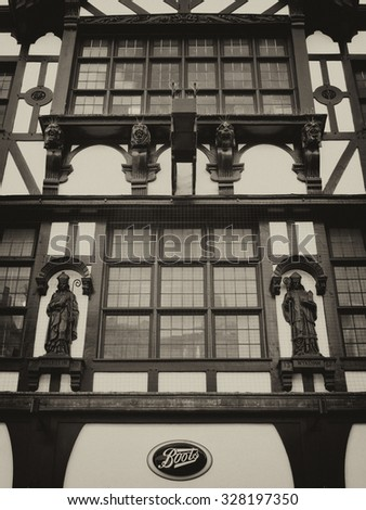 Winchester, High Street, Hampshire, England - September 4, 2015: Historic timber framed Elizabethan period buildings over Boots the chemist retail shop