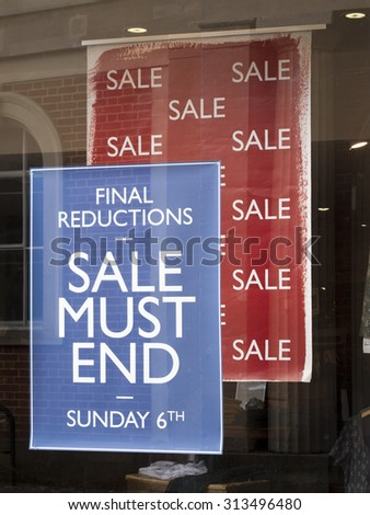 Winchester, Market Lane, Hampshire, England - September 4, 2015: White, Stuff, sale poster in window, company founded in 1985 by George Treves and Sean Thomas - stock photo
