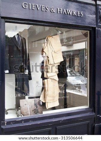 Winchester, The Square, Hampshire, England - September 4, 2015: Gieves and Hawkes bespoke gentleman tailors, one of the oldest continual bespoke tailoring companies in the world - stock photo