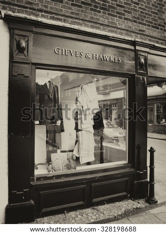 Winchester, The Square, Hampshire, England - September 4, 2015: Gieves and Hawkes bespoke gentleman tailors, one of the oldest continual bespoke tailoring companies in the world