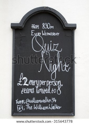 Winchester, The Square, Hampshire, England - September 4, 2015: The William Walker public house quiz night sign on exterior of building - stock photo