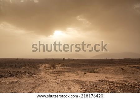 Wind and skittish sky in the desert of Sahara in Morocco - stock photo