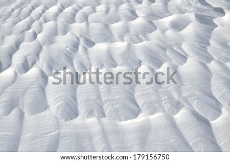 Wind created patterns on a surface of the snow - stock photo