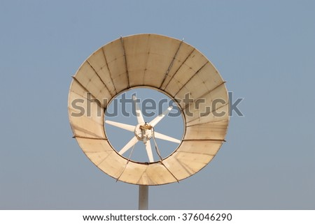 Wind energy, Alternative energy with wind turbine - stock photo